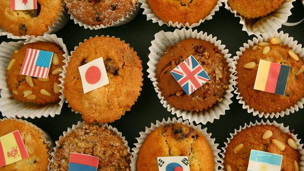 Cakes decorated with international flags (Gareth Fuller/PA)