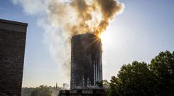 Smoke billowing from the 24-storey Grenfell Tower in west London (Rick Findler/PA)