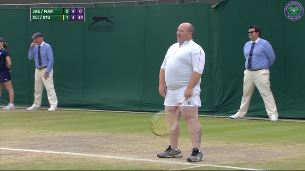 A spectator is invited on court at Wimbledon (Wimbledon/PA)