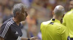 Manchester United manager Jose Mourinho is not taking things easy (Rick Bowmer/AP)