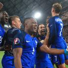 Patrice Evra celebrates with his France team mates – (Nick Potts/EMPICS Sport)