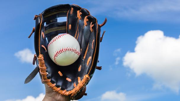 A baseball glove with a baseball in it (Ben-Schonewille/Getty Images)