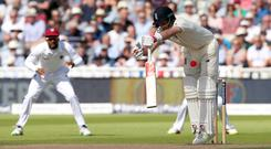 England's Joe Root misses a pink cricket ball