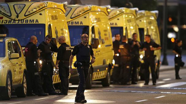 Emergency workers stand on a blocked street in Barcelona
