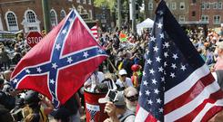 Confederate Flag seen in Charlottesville where white supremacists and counter protesters clashed (Steve Heiber/AP)