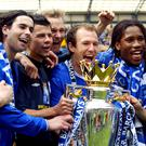 Chelsea footballers celebrate with the Premier League trophy in 2005
