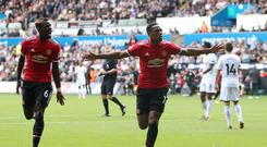 Anthony Martial (right) celebrates scoring his side's fourth goal with team-mate Paul Pogba at Swansea (Nick Potts/PA)