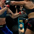 Two female MMA fighters in the ring