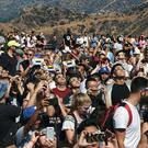 A crowd gathers in Los Angeles to watch the solar eclipse