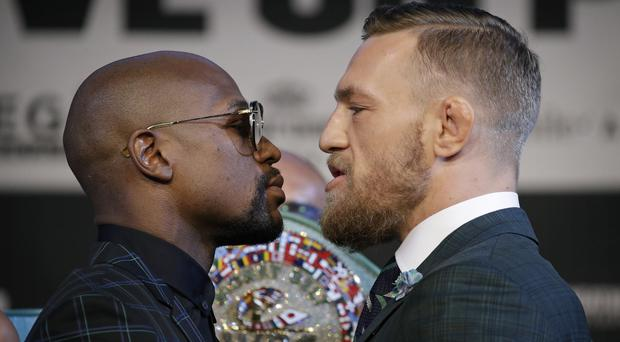 Floyd Mayweather and Conor McGregor ahead of their bout. Photo: AP/PA Images