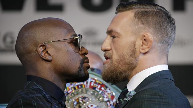 Conor McGregor and Floyd Mayweather square up (John Locher/AP)