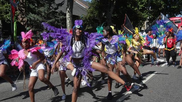 Dancers perform during the Family Day parade at the Notting Hill Carnival in west London (Yui Mok/PA)