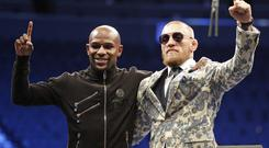 Floyd Mayweather Jr., left, and Conor McGregor