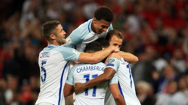 England footballers celebrate with Marcus Rashford
