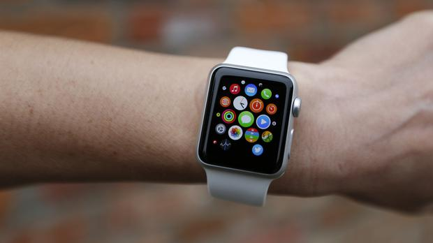 A person wearing the Apple Watch Sport