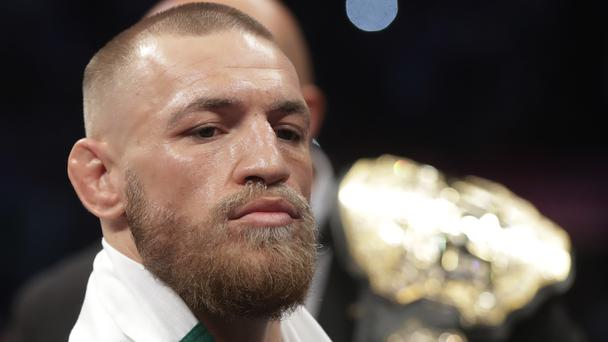 Conor McGregor enters the ring before a super welterweight boxing match against Floyd Mayweather Jr.