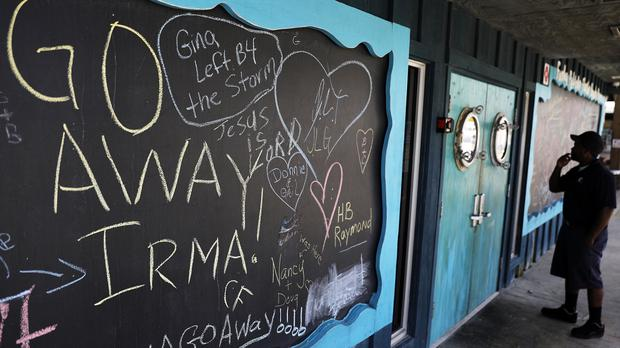 A chalkboard is decorated with messages regarding the approaching Hurricane Irma