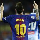 FC Barcelona's Lionel Messi celebrates after scoring during the Spanish La Liga soccer match