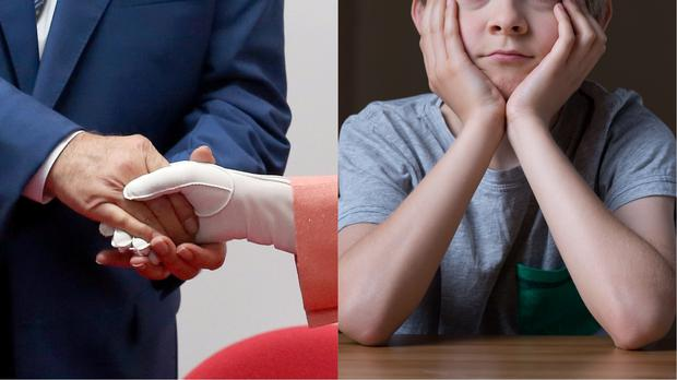 A handshake and a boy with his elbows on the table