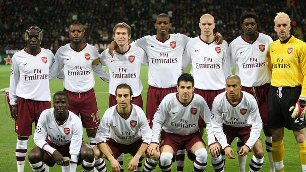 Arsenal players pose for a photograph ahead of a Champions League game