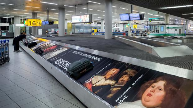 The luggage belt at Schipol airport (Thijs Wolzak/PA)