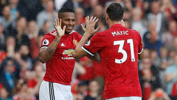 Manchester United's Antonio Valencia (left) celebrates scoring his side's first goal with team-mate Nemanja Matic during the Premier League match at Old Trafford, Manchester.