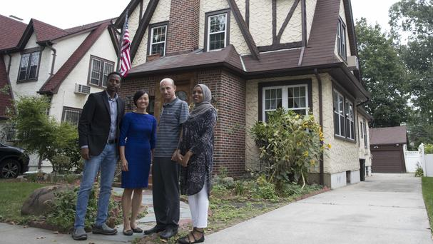Refugees outside Donald Trump's childhood home.