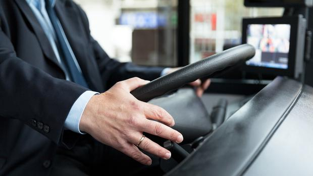 A bus driver at the wheel