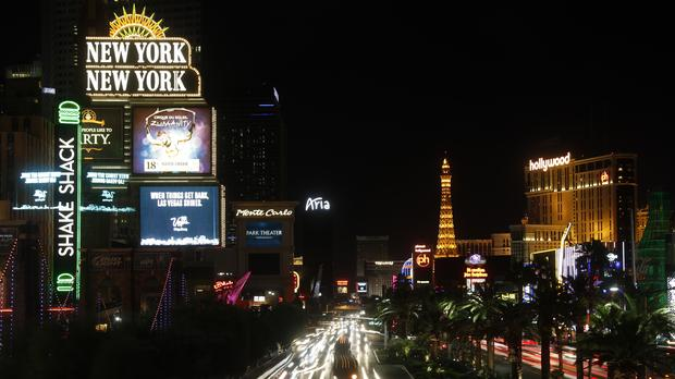 Lights on the world-famous Las Vegas stripped are dimmed one week after a mass shooting (Steve Marcus/AP)