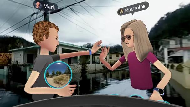 Mark and Rachel Franklin, the head of Facebook's social VR high five in front of a scene in flooded Puerto Rico (Facebook/PA)