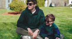 Conor with his young self wearing glasses