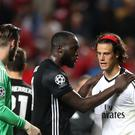 Benfica goalkeeper Mile Svilar is consoled by Manchester United's Romelu Lukaku after a Champions Leagu game