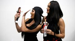 Brie and Nikki Bella with their dolls