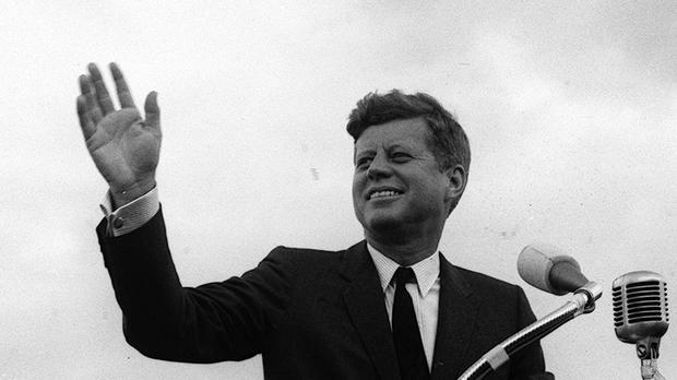 John F Kennedy waves to a crowd