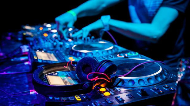 A DJ plays a track at a party