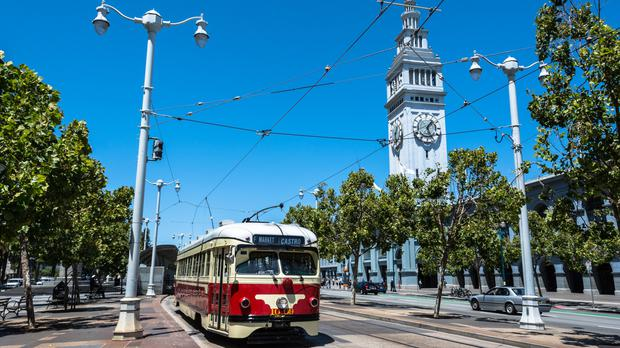 A tram passes in front of the Ferry Building Marketplace in San Francisco (Pikappa/Getty Images)