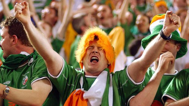 Irish fans celebrate after Ireland striker Robbie Keane's last gasp equaliser in the 1-1 draw against Germany