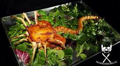 An edible facehugger made from food such as chicken, sausage and crab