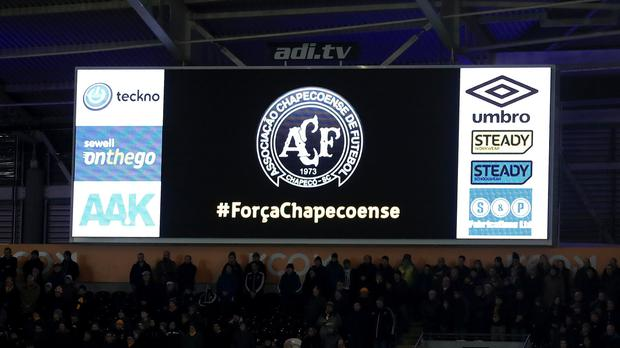 During a minute's silence a scoreboard shows the badge of Brazil team Chapecoense