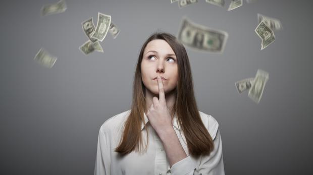 A woman surrounded by falling dollar bills