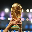 Detail of a Germany player lifting the FIFA World Cup Trophy