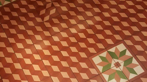 A tiled floor pattern is thrown off by one tile positioned the wrong way around (John Simpson)