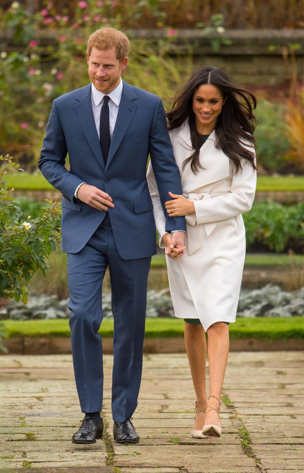 Prince Harry's fiancee Meghan Markle wearing a A/W coat from Line The Label at the official photocall to mark their engagement (Dominic Lipinski/PA)