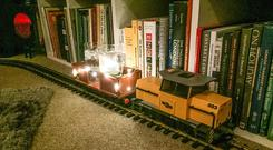 A model train being used to carry gin and tonics