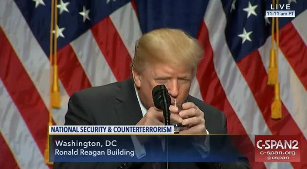 Donald Trump takes a drink of water