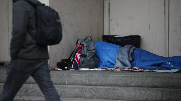 a person sleeping rough in a doorway