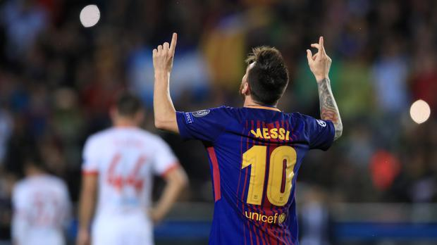 Barcelona's Lionel Messi celebrates scoring a goal in the Champions League