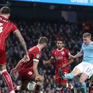 Manchester City's Kevin De Bruyne has a shot blocked against Bristol City