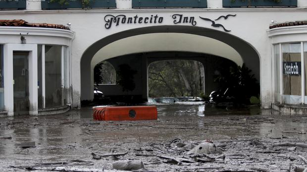 Debris and mud cover the entrance of the Montecito Inn after heavy rain brought flash flooding and mudslides to the area (Daniel Dreifuss/AP)