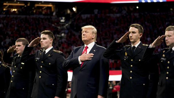 Donald Trump standing for the national anthem